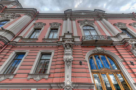 St Petersburg, Russia - July 3, 2018: Beloselsky-Belozersky Palace in the style of Russian neo-Baroque. Figures of Atlantes on the facade of the building.