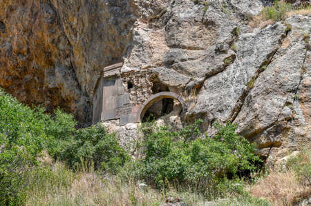 Geghard is a medieval monastery in the Kotayk province of Armenia, carved out of the adjacent mountain.