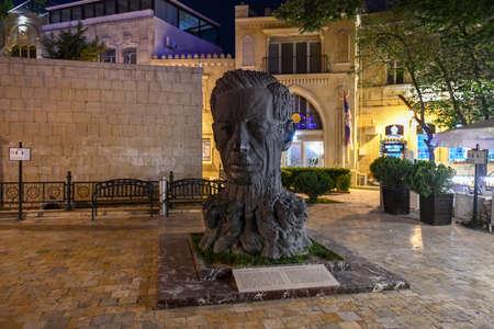 Baku, Azerbaijan - July 14, 2018: Sculpture head of Aliaga Vahid in Old City of Baku. Vahid was Azerbaijani poet, known for reintroducing medieval ghazel style in modern poetry.