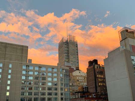 View of NYC skyscraper skyline in midtown Manhattan at sunset.