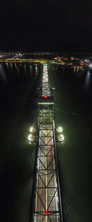 Marine Parkway-Gil Hodges Memorial Bridge as seen from Rockaway, Queens at night. Built and opened in 1937, it was the longest vertical-lift span in the world for automobiles.