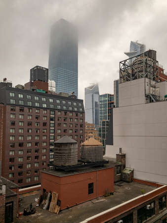 View of the roofs of Midtown Manhattan in New York City on a foggy day.