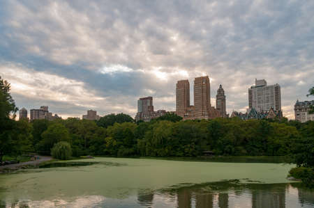 View of apartments overlooking the Conservatory Water in Central Park, New York City. Stock Photo