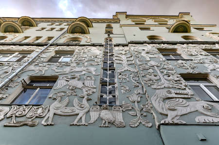 The former profitable house of the Church of the Trinity on Gryazeh in Moscow, Russia, with bas-reliefs of fantastic animals, birds and plants. Stock fotó