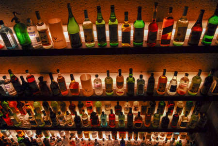 Buenos Aires, Argentina - May 22, 2007: Several types of bottled alcohol and liquor are displayed on some shelves in a pub.