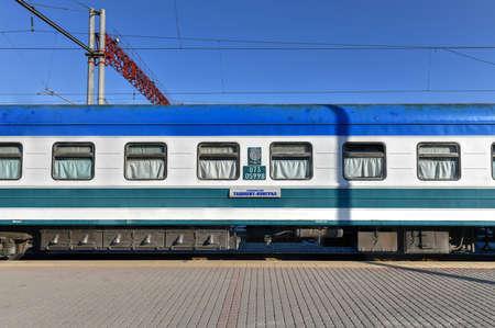 Uzbekistan, Tashkent - July 9, 2019: The Tashkent passenger train and the railway station called Tashkent South.