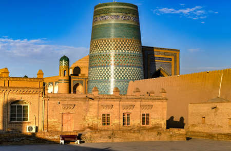 Kalta Minor Minaret and the historic architecture of Itchan Kala, walled inner town of the city of Khiva, Uzbekistan