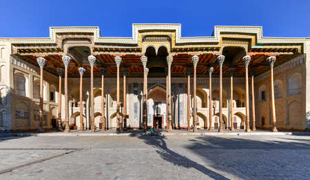 Bolo-Hauz mosque built in the 17th century, with wooden carved columns in Bukhara,  Uzbekistan.