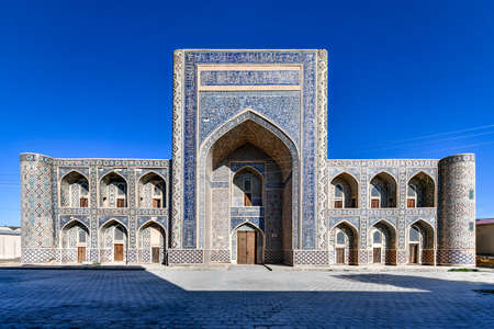 Abdullah Khan Madrassah boasts the perfectly decorated courtyard with the blue tiled traceries on the walls in Bukhara, Uzbekistan. Stock fotó