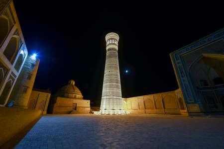Great Minaret of the Kalon in Bukhara, Uzbekistan. It is a minaret of the Po-i-Kalyan mosque complex in Bukhara, Uzbekistan and one of the most prominent landmarks in the city. Stock fotó