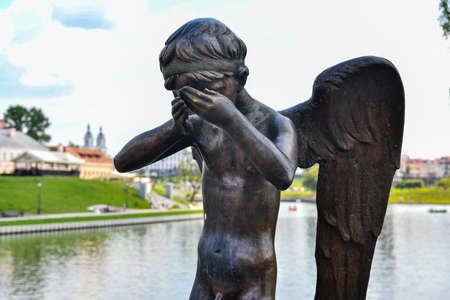 Minsk, Belarus - July 21, 2019: Sculpture of crying guardian angel on Island of Tears, Minsk, Belarus. Publikacyjne