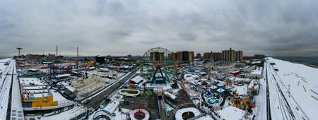 Brooklyn, New York - March 2, 2019: Wonder Wheel and Coney Island Amusement Park covered in snow during the winter in Brooklyn, New York. Editorial
