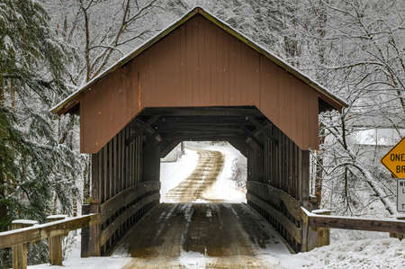 Dingleton Hill Covered Bridge in Cornish, New Hampshire during the winter.
