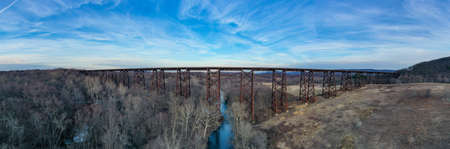 Moodna Viaduct Trestle. The Moodna Viaduct is an iron railroad trestle spanning Moodna Creek and its valley at the north end of Schunemunk Mountain in Cornwall, New York. Фото со стока