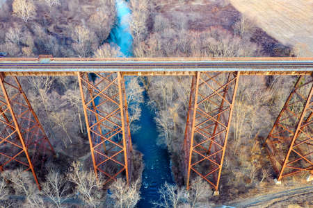 Moodna Viaduct Trestle. The Moodna Viaduct is an iron railroad trestle spanning Moodna Creek and its valley at the north end of Schunemunk Mountain in Cornwall, New York. Stock Photo