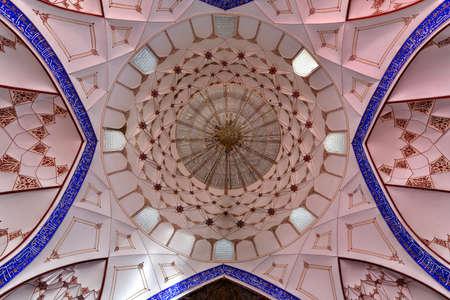 Bukhara,  Uzbekistan - July 13, 2019: Bolo-Hauz mosque built in the 17th century, with wooden carved columns in Bukhara,  Uzbekistan.