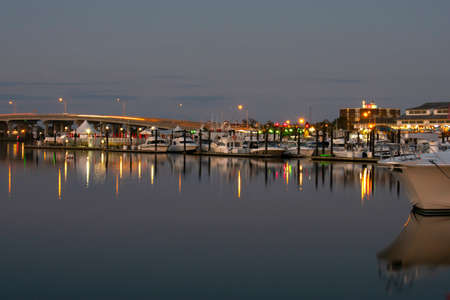 Long exposure of motorboats lining the docks in a marina in Belmar, New Jersey, on a warm autumn evening -08
