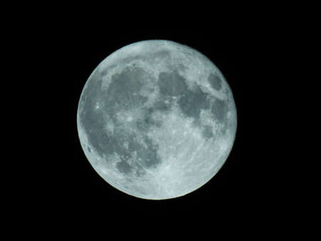 Enhanced to appear bluish, Hunter's full blue moon over Old Bridge, New Jersey. It's called a blue moon because it is the second full moon of the month Imagens