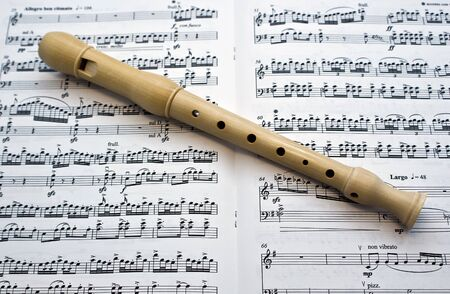Flute on a musical paper