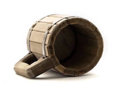 overturn: Wooden mug on a white background  Stock Photo