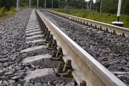 cross ties: Rails of the railway. Focus on fastening of a cloth