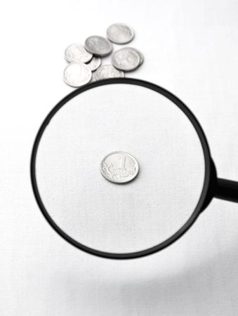 increased: Ñheap coin increased through a magnifier