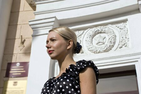 establishment: The beautiful stylish girl on a background of establishment with the Soviet symbolics  Stock Photo