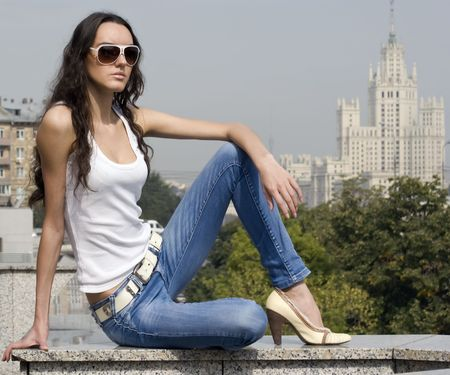 urbanistic: The young girl on a  Moscow University background