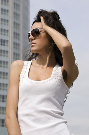 urbanistic: The young girl on a  skyscraper in City background  Stock Photo