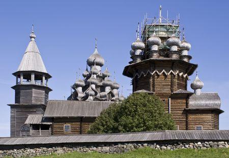 Karelia. Kizhi Island. A belltower and Preobrazhenskiy church and churchyard   photo