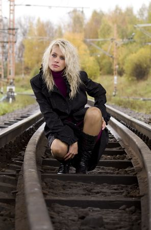 Beautiful woman on railway tracks Stock Photo - 6249622