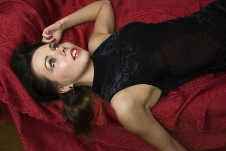 Dead woman lying on the sofa. Studio shot.      photo