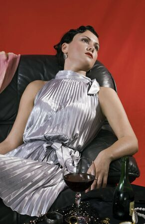 swooned: Poisoned young woman. Studio shot in a retro style Stock Photo