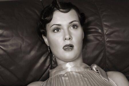 swooned: Strangled beautiful young woman. Studio shot in a retro style