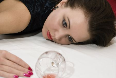 poisoned: Crime scene: young poisoned woman lying on the floor. Studio shot.