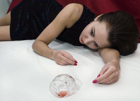 Crime scene: young poisoned woman lying on the floor. Studio shot. Stock Photo - 6275668