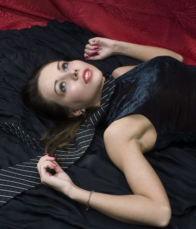 Young strangled woman on the floor. Studio shot. photo