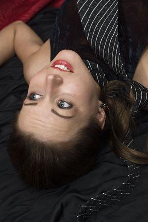 Dead strangled woman on the floor. Studio shot. Stock Photo - 6275709