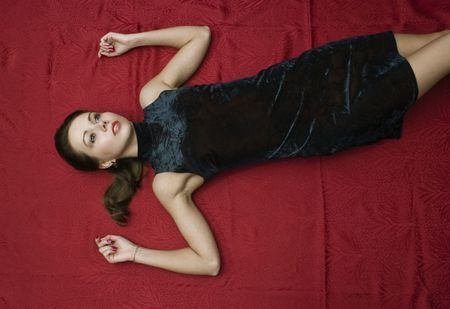 Dead young woman on the floor. Studio shot. photo