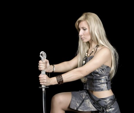 scandinavian people: Beautiful girl with sword on a black background