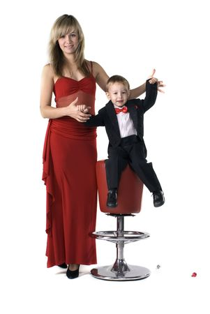 Young mother in a red dress and the little boy in a suit Stock Photo - 6336294