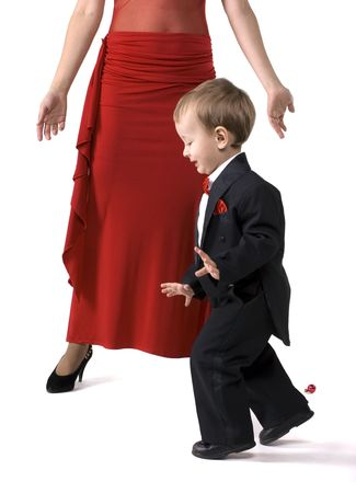 tiptoes: The little boy in a suit tiptoes Stock Photo