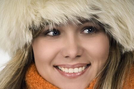 Winter portrait of the young attractive girl. photo