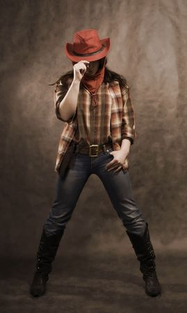 American cowgirl in a western movie style