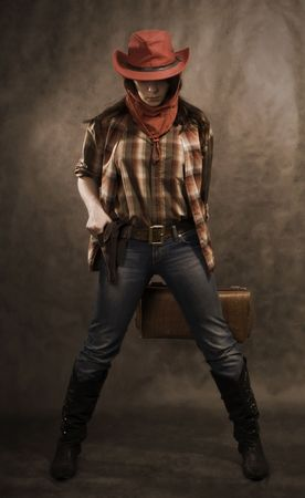 Portrait of a cowgirl. Western movie style photo