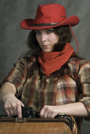 American cowgirl in a western movie style photo