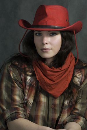 Portrait of a cowgirl in a hat. Western movie style photo