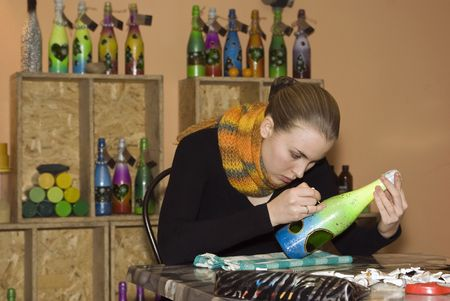 A girl at work in the workshop on hand-made decorative items photo