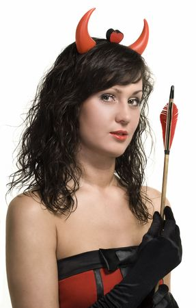 Beauty attractive red devil girl with arrow over white Stock Photo - 7494702