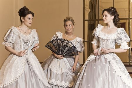 evening ball: Picture of three young women in ball gowns